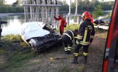 L'Adige restituisce un'auto con resti umani